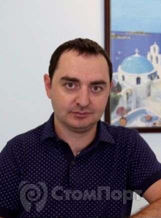 Роман Василиадис